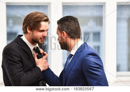 Businessmen Fight In Suit. Investment Risk Concept