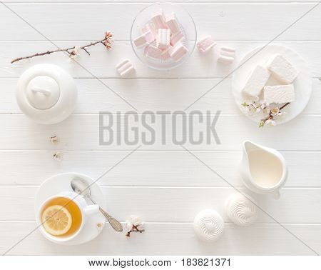 Tea with lemon, macaroon and pink marshmellow, additional space for text left