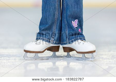Close-up of Legs in Skates on Skating Rink