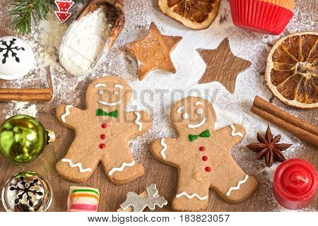 Vintage Christmas decoration with gingerbread  on wooden background