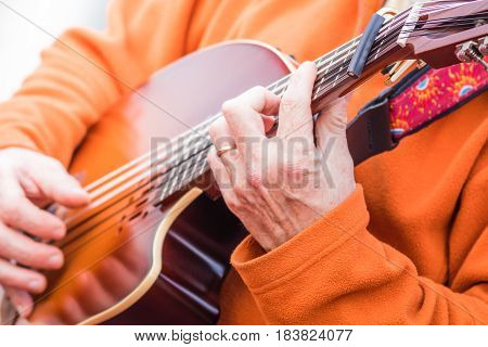 Playing and strumming beautiful electric lute guitar (Oud)