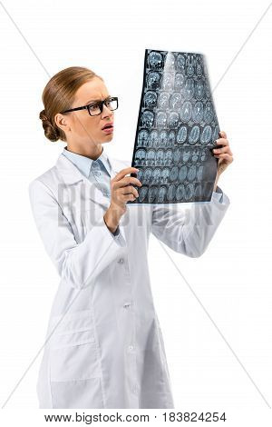 Female Doctor Standing In White Coat And Holding X-ray Isolated On White