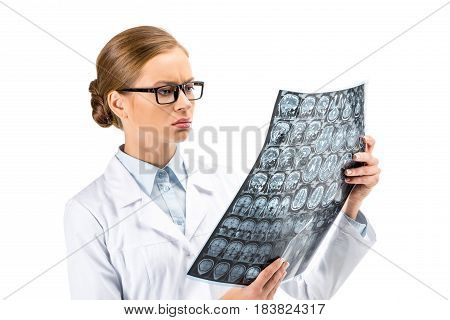 Serious Female Doctor Standing In White Coat And Holding X-ray Isolated On White