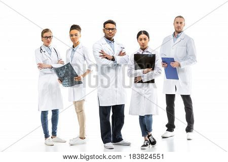 Team Of Young Professional Doctors In White Coats Standing Together Isolated On White