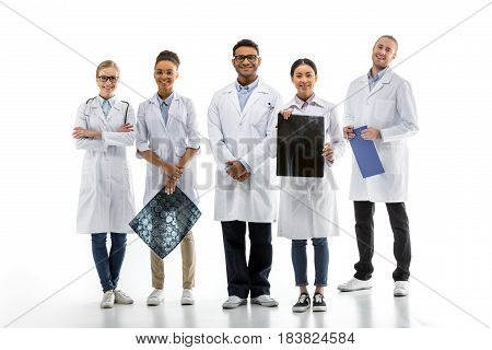 Team Of Young Professional Doctors Standing Together Isolated On White