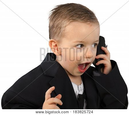 Shocked Little Boy in a Large Jacket Talking on Phone - Isolated