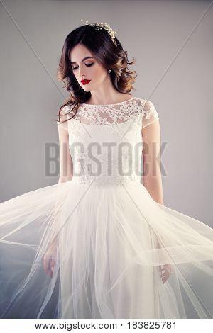 Beauty Fashion Portrait of Pretty Fiancee wearing White Wedding Dress