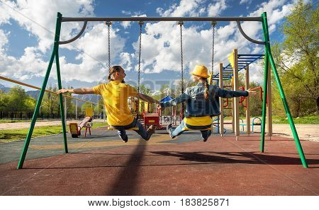 Happy Couple Riding At Swings