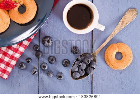 Breakfast with biscuits, coffee and fresh fruit.