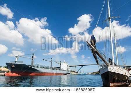 Sailboat and Tanker in Curacao Harbor by Bridge