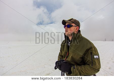 2014 07 Mount Elbrus, Russia: Man looks at the top of Elbrus from station Shelter 11
