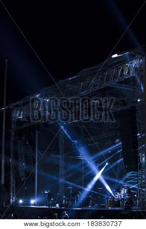 Stage with a blue rays of light