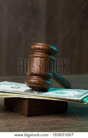 Hammer on bills at table