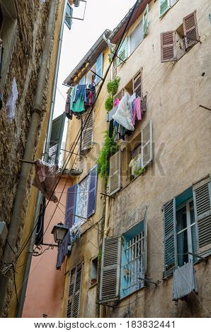 Grasse, France. June 6th 2016..Clothes hanging to dry on a clothes-line at the balcony on a residence of the city og Grasse