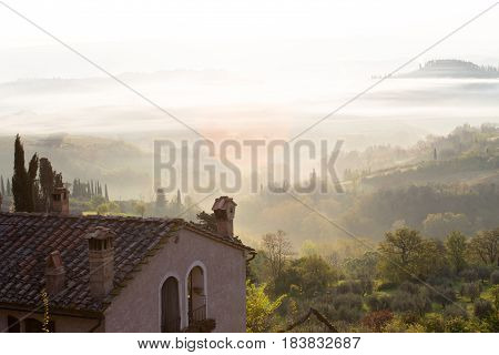 foggy morning at the Toscana with the rising sun beams poster