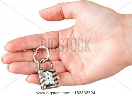 Hand Holding Keychain Lock With Clock And Key - Isolated