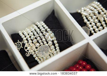 Gemstones handmade Bracelets on Shop-window. Fashion accessories