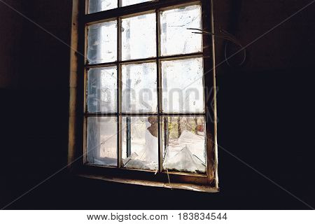 Broken window glass, view from inside abandoned building in Russia, Voronezh