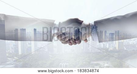 Business handshake as symbol of deal