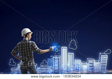 Builder woman sketching city