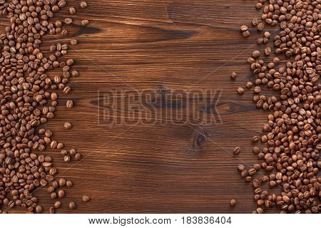 Coffee Beans On A Wooden Background. A Frame Of Coffee Beans For Your Text.
