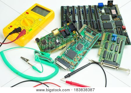 Digital clamp meter, antistatic wrist strap and computer circuit boards