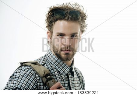 trendy guy or trip fashion model handsome man or smart male student businessman with beard and stylish blond hair in nerd glasses on head and checkered shirt with suspenders. Study and knowledge