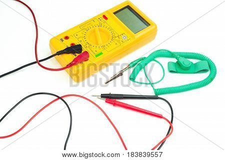 Yellow digital clamp meter and green antistatic wrist strap