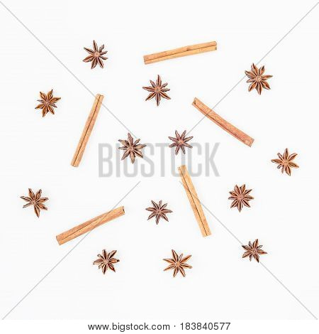 Natural pattern made of cinnamon and anise tree on white background. Spice. Flat lay. Top view.