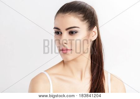 portrait of young beautiful woman brunette with natural makeup. the girl with clean skin