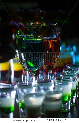 Glasses With Colorful Cocktails And Layered Shots