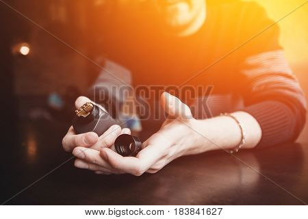 vaping man holding a mod. concept of refusal of tobacco. Vaping high contrast and monochrome color tone.