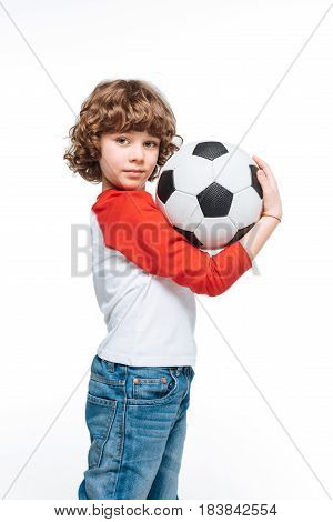 Little boy with soccer ball isolated children sport concept