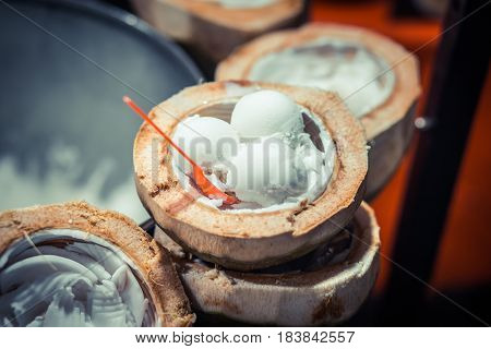 Coconut ice cream in coco shells. Natural desert