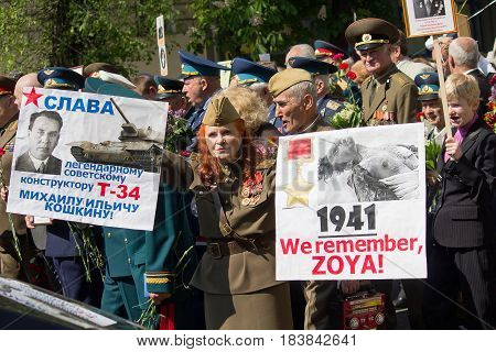 Kiev Ukraine - May 9 2016: Veterans on the march in honor of the anniversary of victory in the Second World War. On the poster there is an inscription in Russian: