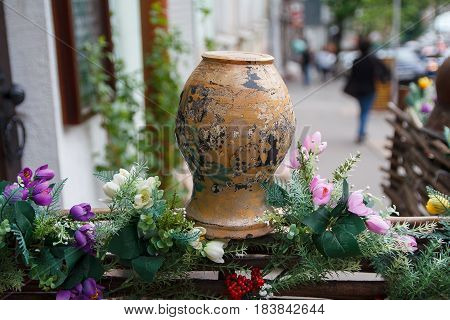 Decoration of the cafe in the form of a clay pot on the fence. Kiev Ukraine