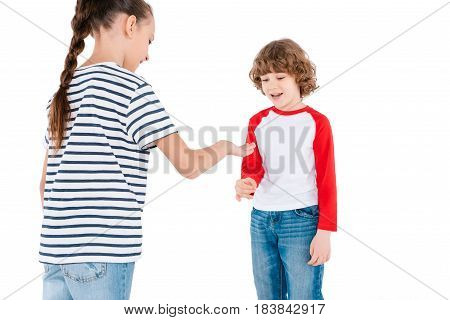 Cute boy and girl playing in rock-paper-scissors game isolated on white