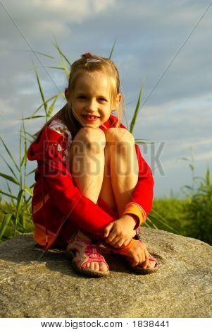 Girl On Stoun Near Sea