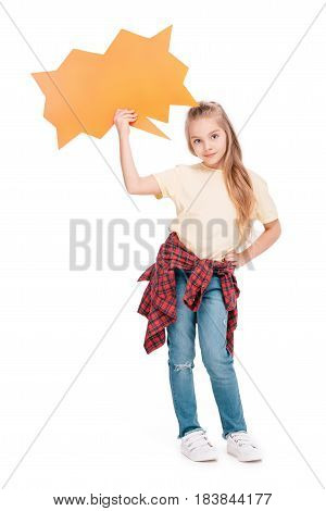 Young girl holding orange speech bubble near head isolated on white