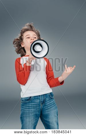 curly Boy using loudspeaker isolated on gray