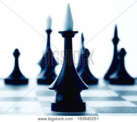 Black and White Chess Piece on Chessboard - Isolated on White