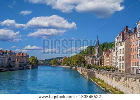 The river Saone view with Church of Saint Georges and footbridge in the city center of Lyon, France