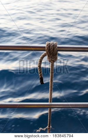 Photo of tied rope aboard sea boat