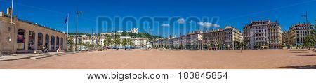 Amazing huge wide panoramic view on Place Bellecour with a blue sky. Place Bellecour is a large square in the centre of Lyon, and is the largest open square in Europe.