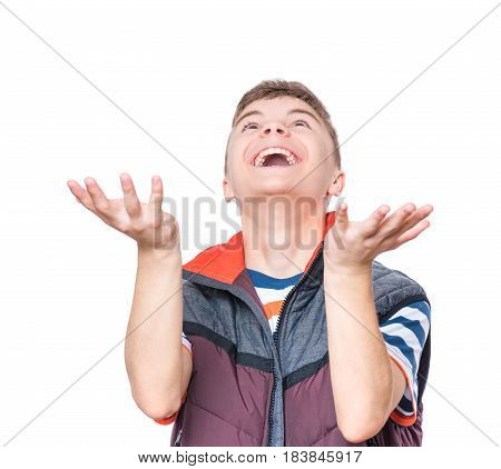 Cheerful handsome teen boy with raising hands waiting to catch something. Emotional portrait of caucasian happy cute laughing male child, isolated on white background.