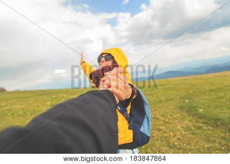 Couple enjoying together in the nature / mountain landscape.