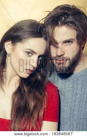 Young couple caucasian hipster with beard unshaven with moustache hugging on beige wall