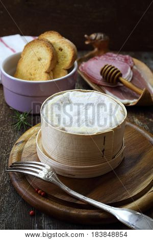 French Vacherin Mont d'Or cheese cold cuts for cheese fondue