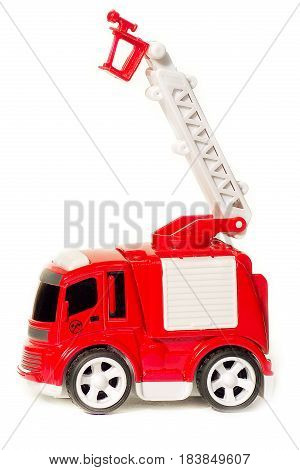 car toy red fire truck with extendable ladder and basket, copy space