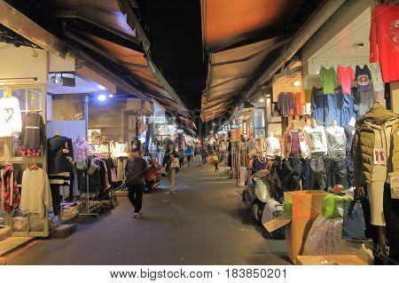 TAIPEI TAIWAN - DECEMBER 7, 2016: Unidentified people visit Wu Fen Pu street clothes market. Wu Fen Pu is best known for the massive wholesale garment market.